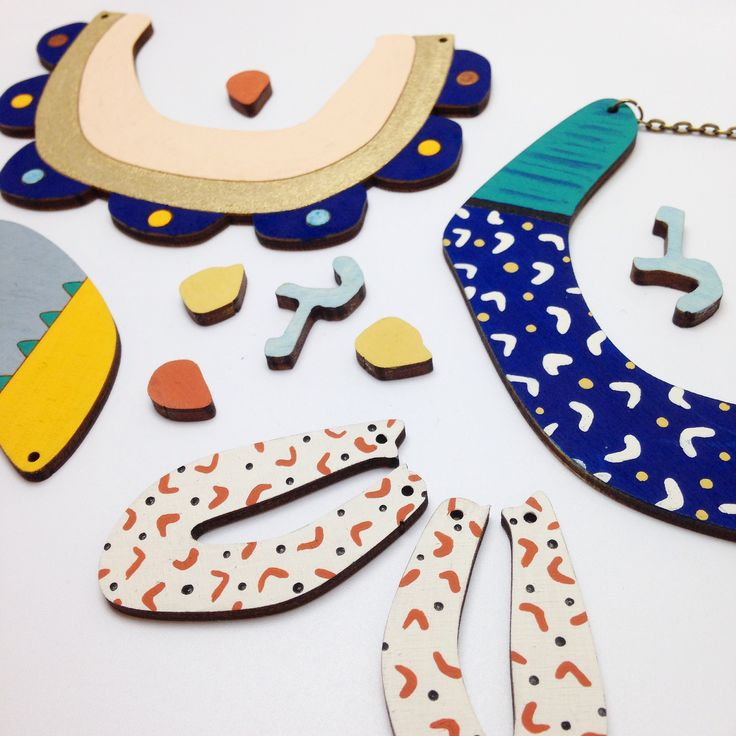 Red Paper House hand painted laser cut wooden jewellery. New collection inspired by cave paintings.