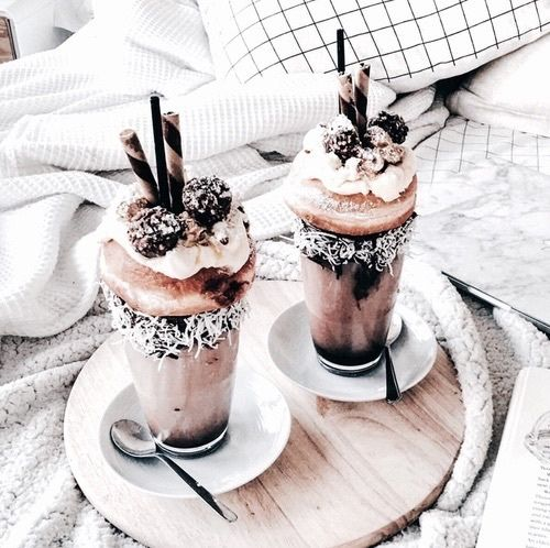 For an indulgent treat try a monster shake piled high like this one featuring a chocolate Oreo milkshake, doughnut, truffle, whipped cream & edible straws decorated with a chocolate & coconut rimmed long glass #treatdays...x