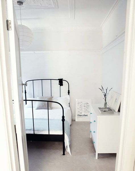 another guest room idea, love all the white with stark bed frame and grey floors.