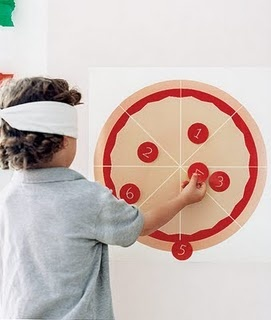 """Pin the pepperoni on the pizza. The kids, blindfolded, get five points for pinning the pepperoni on the center of the pizza, two points for placing it directly on a slice without touching a line, and one point for hitting the crust.     Meatball race. Kids form teams and deliver a """"meatball"""" (a golf ball or a racquetball) on a spoon to a designated location and back without dropping it."""