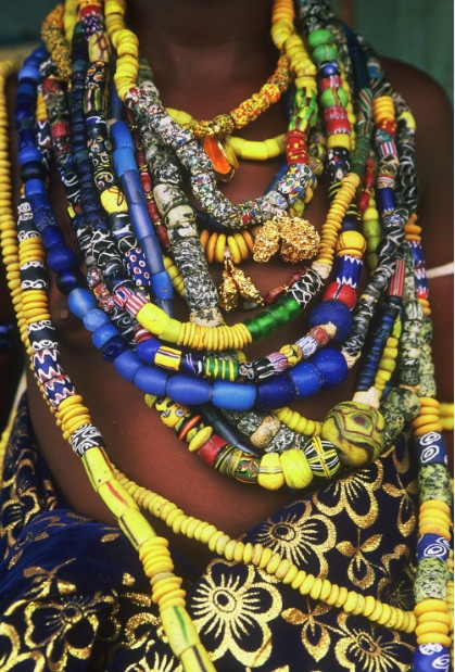 Africa |  Details of the beads worn by a Krobo girl | © TransAfrica, most beads are West African sandcast Krobo beads strings of blue ones may be trade beads