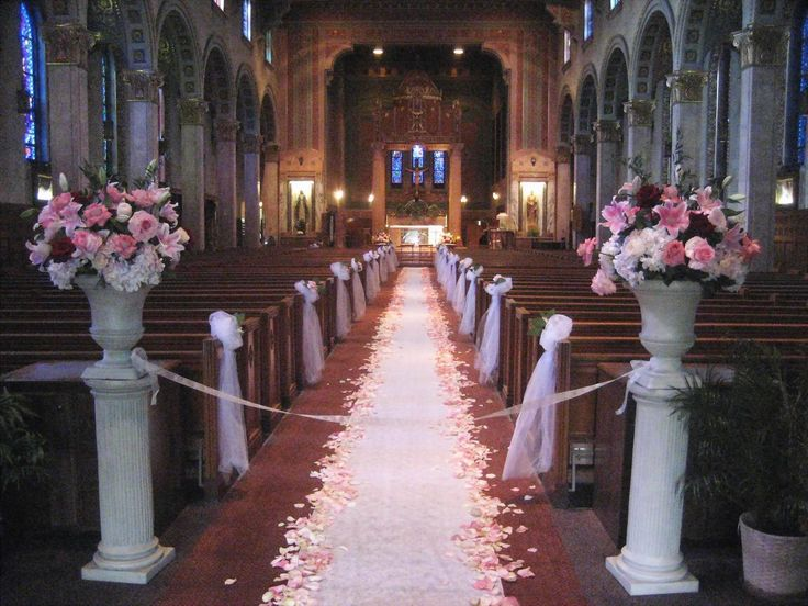 Create your wedding ceremony blooms to all coordinate with one another for a cohesive appearance. Big pink blooming flowers with pink petals aligning the aisle is such a pretty appearance.  http://palominofloraldesigns.com/  #weddingflowers #ceremony #petals #weddingaisle #palominofloraldesigns