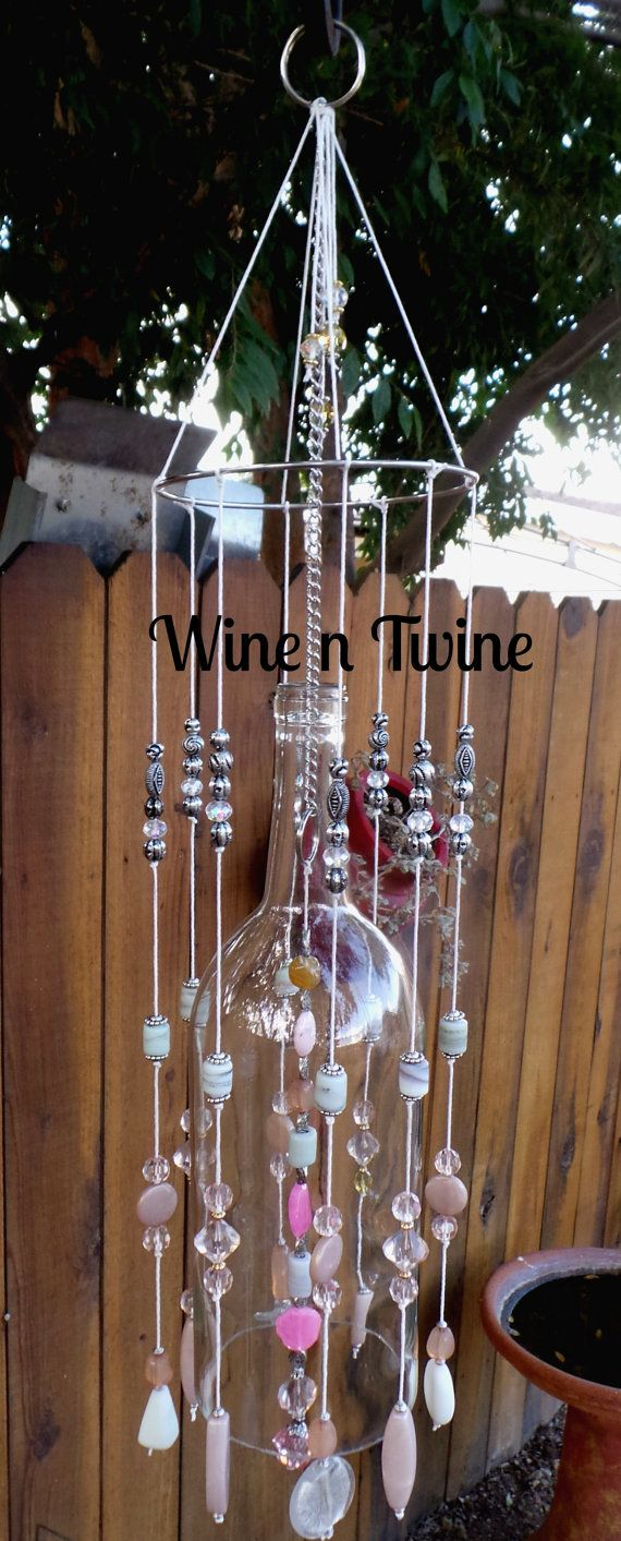 This is an original, one-of-a-kind wind chime. Made from a recycled 1.5 ml wine bottle Tom has created a wind chime that has a mixture of beads,