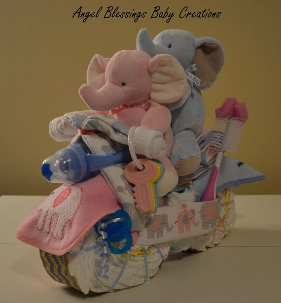 This beautiful twins motorcycle centerpiece can be made to order to match your colors and/or baby shower theme. Each diaper centerpiece is