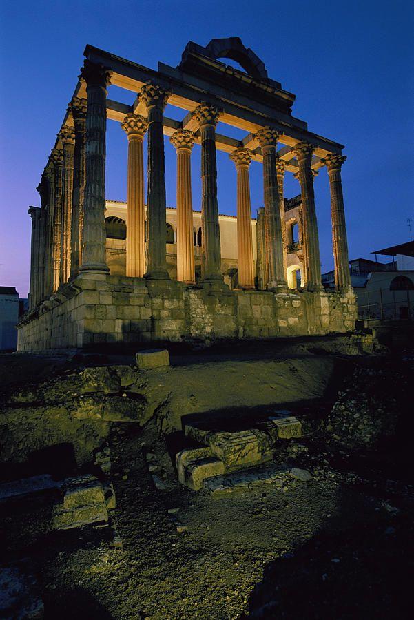 View of the Roman Temple of Diana, illuminated at dusk - Merida, Spain, UNESCO, World Heritage Site, 1993