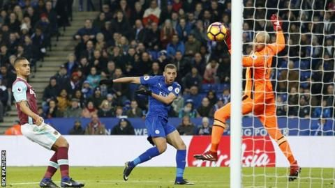 Islam Slimani heads Leicester City into the lead against West Ham