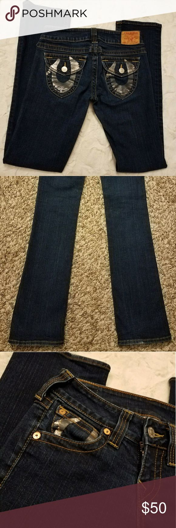 "True Religion Straight Leg Johnny Dark Wash Jeans Brand New! Worn once, in Amazing condition, very high quality! Straight Leg Johnny Jeans a straight leg cut with flap button back pockets with silver ""painted on"" signature True Religion horseshoes! WAIST 28"" INSEAM 32"" RISE 6.5"" leg opening 7"" True Religion Jeans Straight Leg"