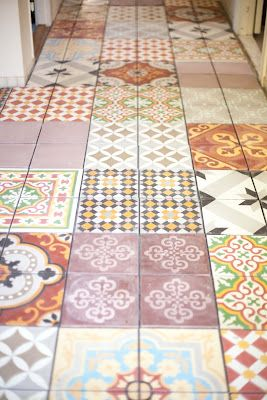 I love a patchwork of tiles. Eclectic, interesting & creates a warmth to the home.