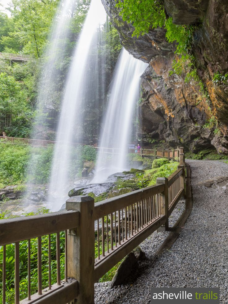 Dry Falls is a short, kid-friendly hike to a tumbling waterfall that you can walk behind, near Highlands, NC