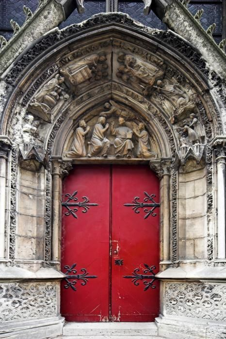 Notre Dame side door, Paris, France - The stoneware around this door is beautiful but the door could use a spruce up.  The hardware is beautiful in its simplicity.