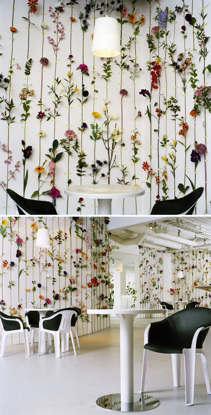 An installation of silk and plastic flowers simply mounted on walls by Swedish design group Front.