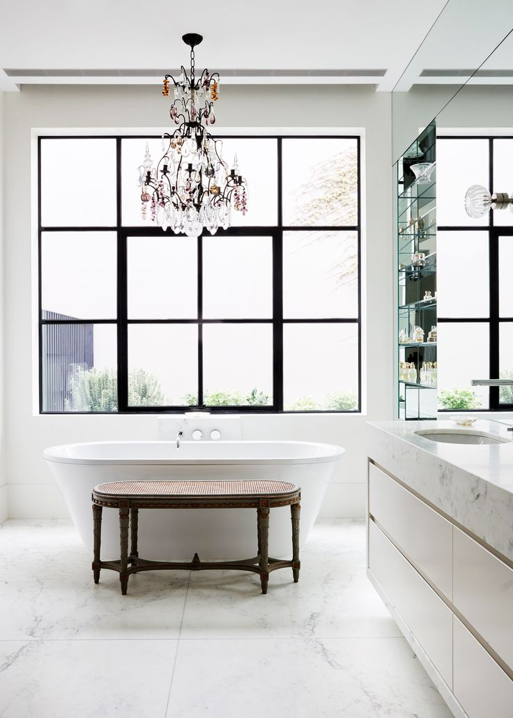 A French chandelier accentuates the drama of this freestanding bath within a heritage home. | Photo: Sean Fennessy | Story: Belle