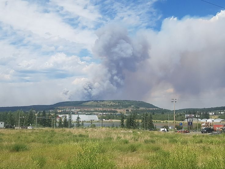 Smoke over/ behind West Fraser mills in 100 Mile House B.C, Gustafsen fire,July 2017, B.C.wildfires 2017