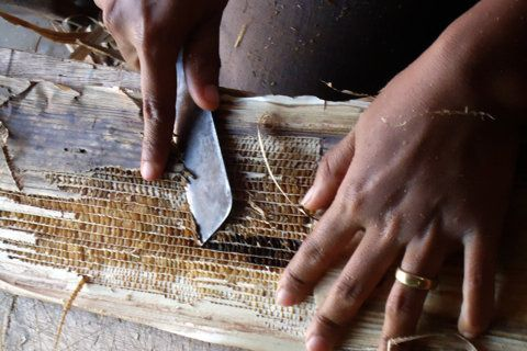 Local artisan workers making the signature banana leaf boxes - www.pantheia.com