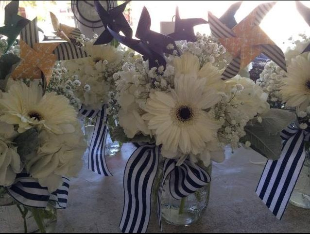 Nautical centerpieces, pinwheels, mason jars