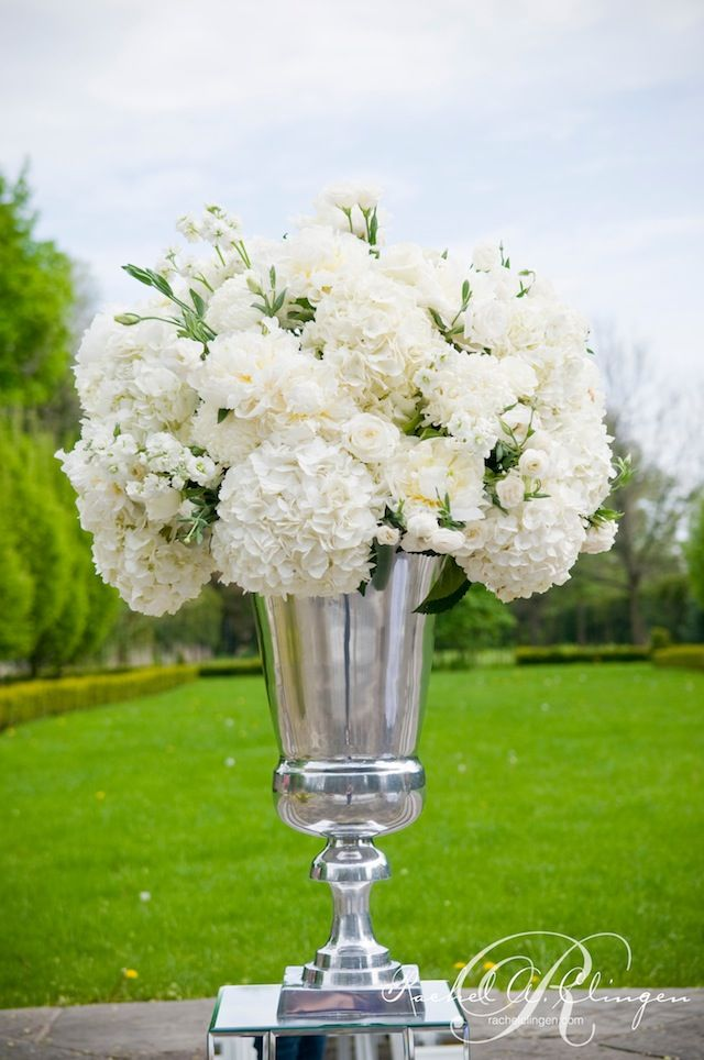 white reception wedding flowers,  wedding decor, wedding flower centerpiece, wedding flower arrangement, add pic source on comment and we will update it. www.myfloweraffair.com can create this beautiful wedding flower look.     ceremony flowers by Rachel A. Clingen
