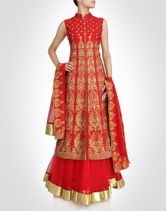 Lehenga with a red backdrop and gold accents. Shop Now: www.kimaya.in