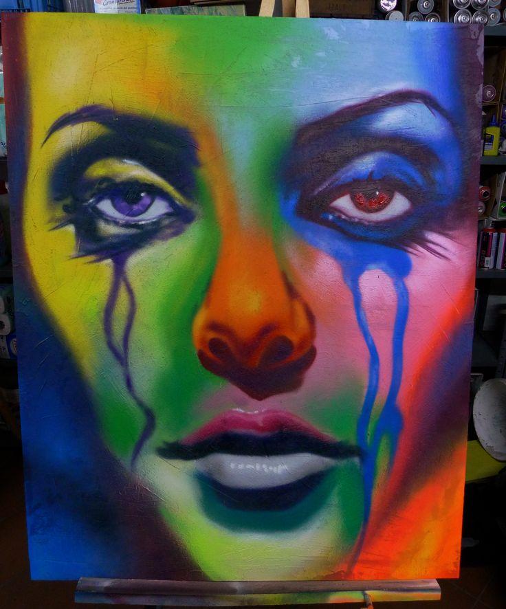 Quadro raffigurante una ragazza in lacrime, opera di street art realizzata con spray a mano libera su tela