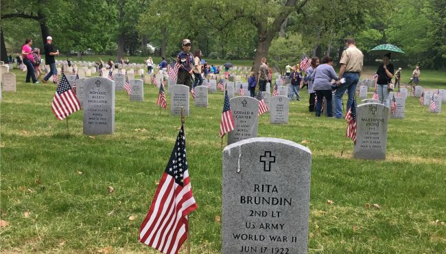 Scouts and their families placed American flags by each of the about 5,300 grave markers at the Grand Rapids Veterans Home Cemetery.