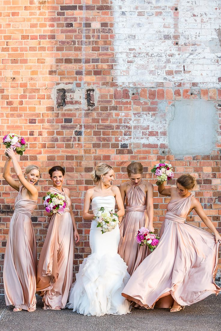 nice blush bridesmaid dresses and awesome bride in Vera Wang wedding dress