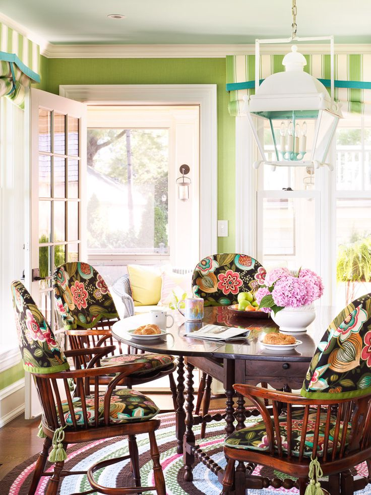 colorful floral print on chairs ~ Anthony Baratta design.interesting way to  cover chairs