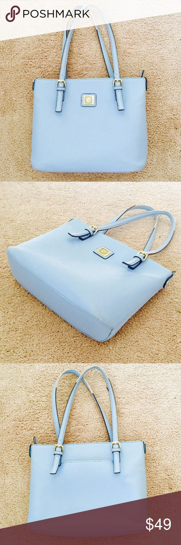 ❗Nordstrom's Anne Klein Sky Blue Tote ❗️Anne Klein from Nordstrom's Sky Blue Tote. Sleek & perfect for spring! Great condition some wear to top handles as shown. Make an offer! I consider all reasonable offers on items & give great bundle deals! Winter cleanout sale ;-) Nordstrom Bags