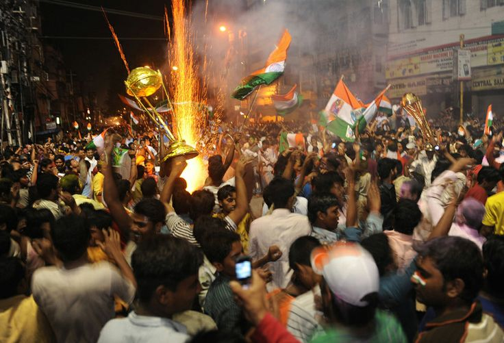 Indian cricket fans celebrate victory over Sri Lanka in Siliguri on April 2, 2011, after the ICC Cricket World Cup 2011 final match between India and Sri Lanka. India defeated Sri Lanka by six wickets to win the 2011 World Cup at The Wankhede Stadium in Mumbai. (DIPTENDU DUTTA/AFP/Getty Images)