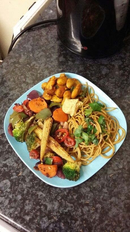 Part 1 Post-workout meal was so tasty today ❤ Wholewheat spaghetti pasta (75g at serving) cooked with garlic + soya sauce (recipes below), red pepper + chilli hummus, spicy butter bean curry and sautéed vegetables from yesterday. Also a mango black tea from @ahmadtea which was tropically delicious!   Here's My Recipes... Wholewheat Spaghetti Pasta: I simply boiled the spaghetti and drained the water. In a separate pan, I used a drop of olive oil to sauté 1 finely chopped garlic clove and let…