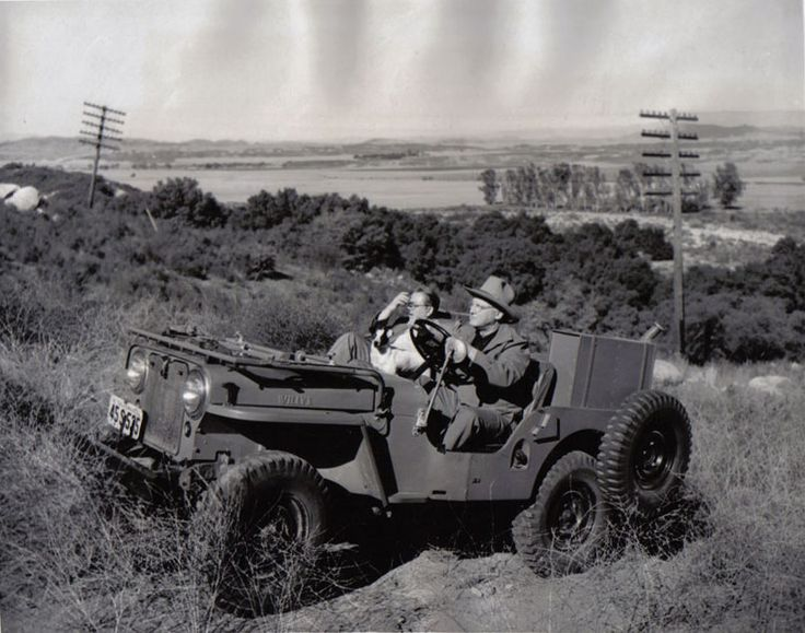 Erle Stanley Gardner drives AP reporter Howard Heyn around his Rancho del Paisano in Temecula, California, 1950.
