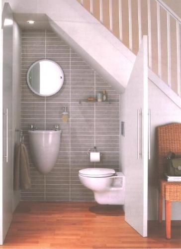 half bath under the stairs. great use of the space!