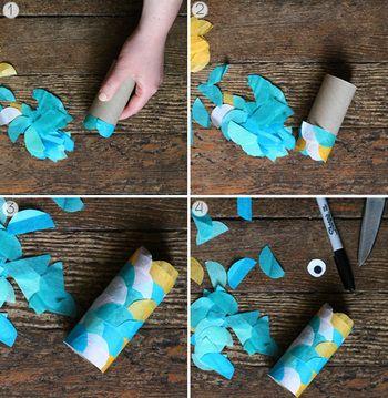 1、トイレットペーパーの芯に、半円状にカットしたカラフルなペーパーを鱗のように貼り付ける。 2、鯉のぼりに目玉をつける。