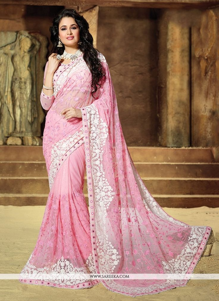 Precise attractiveness will come out through the dressing trend with this rose pink net designer traditional sarees. The pretty embroidered and patch border work all through the dress is awe inspiring...
