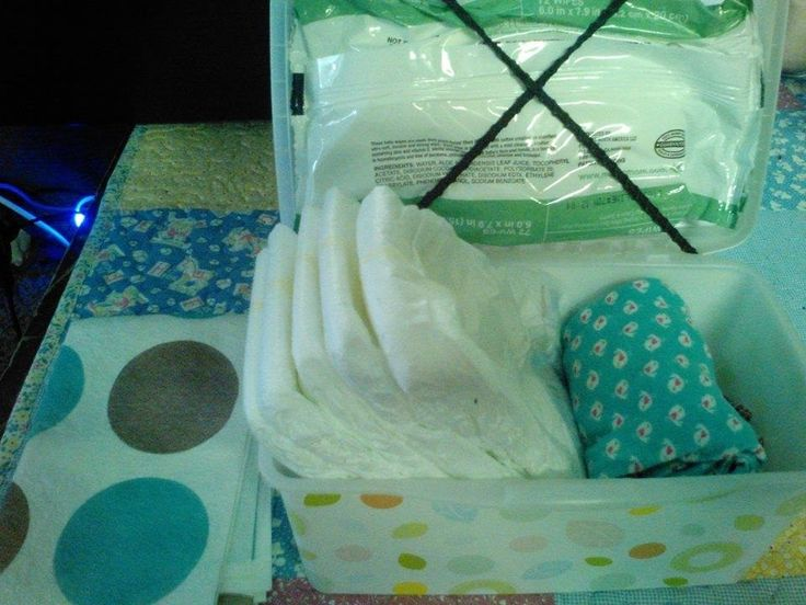You can also convert a totally normal box of wet wipes into a diaper bag. To do so, you just need two rubber bands that strap the wet wipes to the lid. Then, you'll have plenty of room in the box for underwear and diapers.