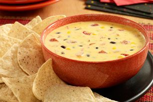 Queso recipe made with Ro*Tel zesty tomatoes and the colorful addition of black beans and corn.