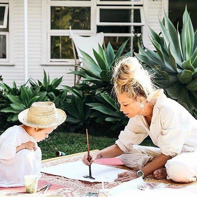 Sheree Commerford and her toddler painting outside