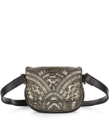 - All over embellished purse- Concealed fastening- Leather-look finish