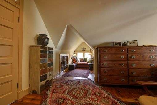 A new attic master bedroom suite includes this just-tall-enough-to-walk-in reading nook