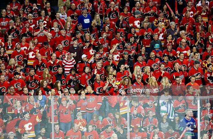 A Calgary Flames fan dressed up as 'Where's Waldo' is a sea of red jerseys during Game Six of the Western Conference Quarterfinals during the 2015 Stanley Cup Playoffs at the Scotiabank Saddledome on April 25, 2015 in Calgary, Alberta, Canada.