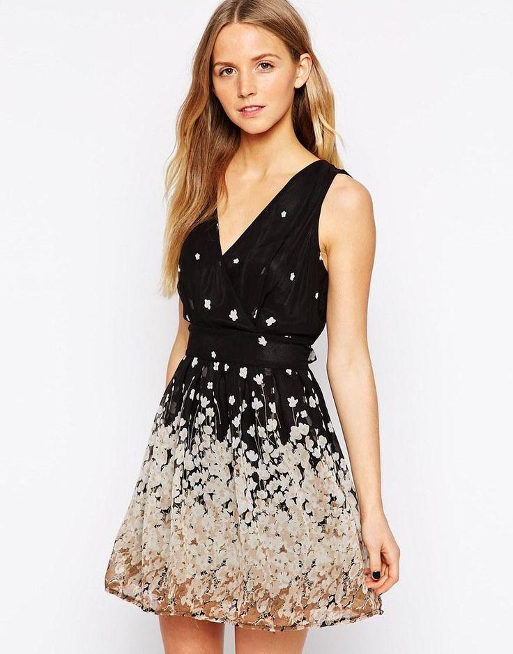 Yumi | Yumi Wrap Front Dress with Border Floral Print at ASOS