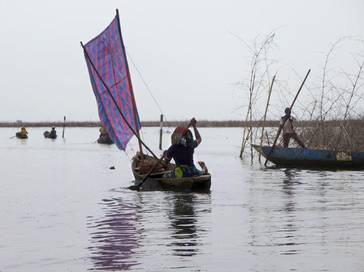 A Tofinu villager sails out onto Lake Nokoue near Cotonou, Benin.