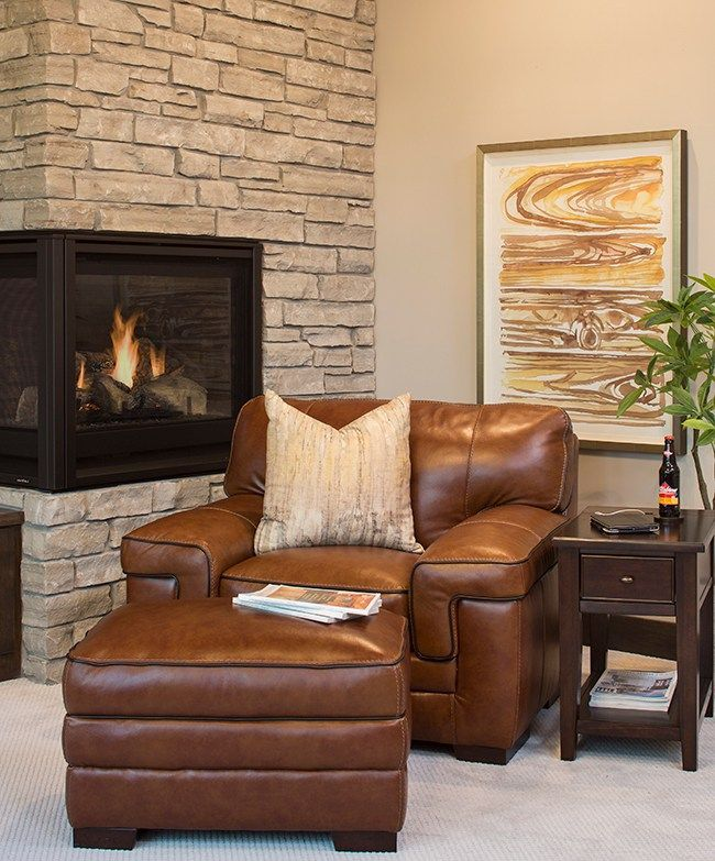 Cozy Nook By The Stacked Stone Fireplace With An Overscaled Leather