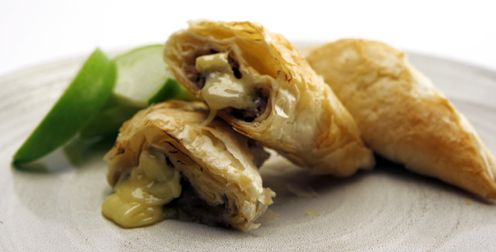 Brie, Apple and Walnut Phyllo Triangles - Recipes - Best Recipes Ever - A perfect fusion of Brie, apple and walnuts hides inside crisp, buttery phyllo pastry. Since they freeze beautifully, you may want to make several batches to have on hand for impromptu get-togethers or to take to potluck suppers....