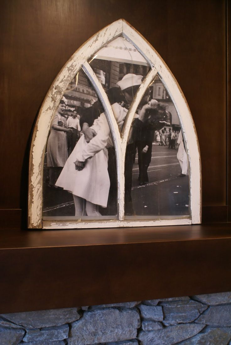 Everyone is in love with these 1928 Arched Church Windows that we scooped up in Compeer Alberta Canada! SO many ideas on how to decorate with them. We cut a poster to fit in the frame, it's like you are looking through your window, out onto your front street back in 1945.