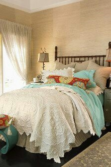 Vintage bedding. Love the old lace and the soft Southwestern color scheme.