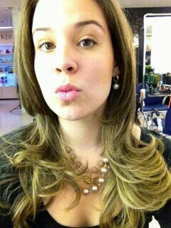 Gold-tone blonde highlites; haircut and blow dry by Diniz.