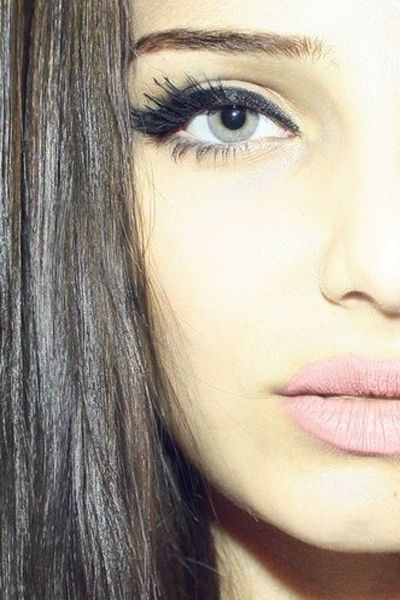 Go thick on the black eye liner and mascara and a bubblegum pink lip, but keep the rest of the eye bare.