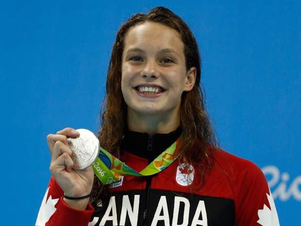 Silver medalist Penny Oleksiak of Canada beams on the podium during the medal ceremony for the women's 100m butterfly final on Day 2 of the Rio 2016 Olympic Games at the Olympic Aquatics Stadium on August 7, 2016.