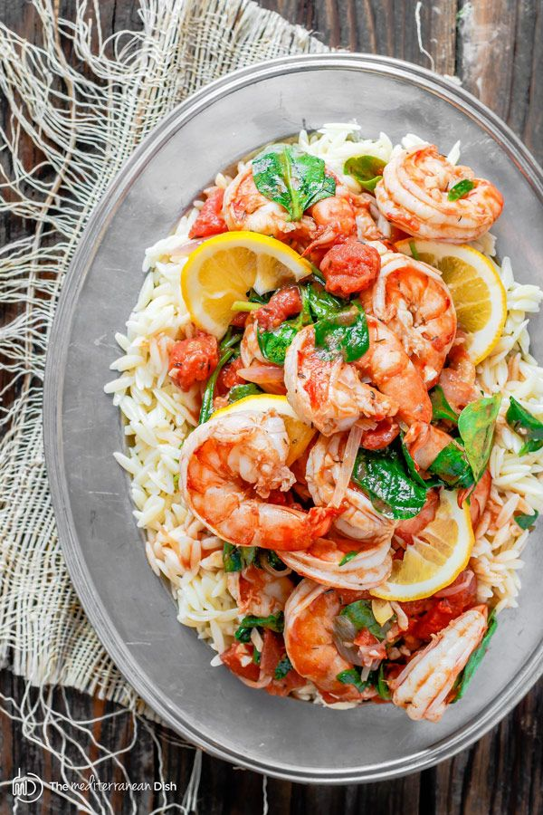 Garlic-Tomato Shrimp Recipe with Orzo - A few ingredients like white wine, lemon juice, garlic and tomatoes make a special flavor-packed sauce for the prawns or shrimp. Add a simple orzo or pasta of your choice and voila!