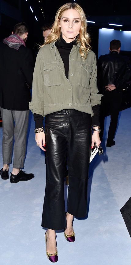 IOlivia Palermo hit the Paris Fashion Week circuit in a street-style take on a utilitarian look, featuring a black turtleneck layered under an army green shirt and tucked into a pair of leather culottes. The finishing touch? Tortoiseshell frames and two-tone pumps.