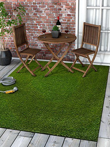 "Super Lawn Artificial Grass Rug Indoor / Outdoor Carpet Synthetic Turf Fade Resistant Easy Care 5'3""x7'3""  Thick, lush 20mm (0.8"") pile height. Non-toxic, eco-friendly polyethylene pile.  UV resistance prevents fading and promotes longevity. Synthetic material won't stain.  Densely woven, multi-tone blades with thatching for a natural look.  Rubber coated backing is rugged, durable, and features drainage holes to prevent water pooling.  Artificial material is naturally resistant to bac..."